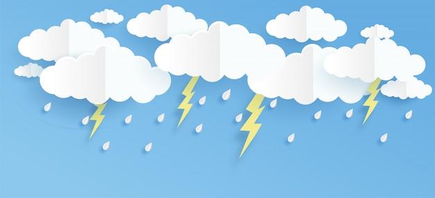 Wolk en regen op blauwe achtergrond in papier knippen en ambachtelijke stijl.