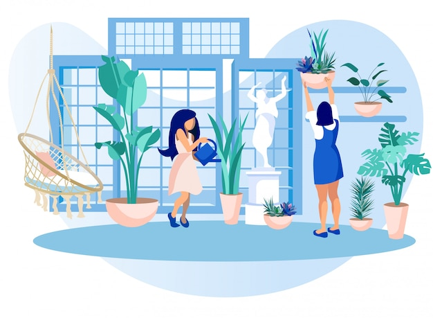 Women in greenhouse orangery care of garden plants