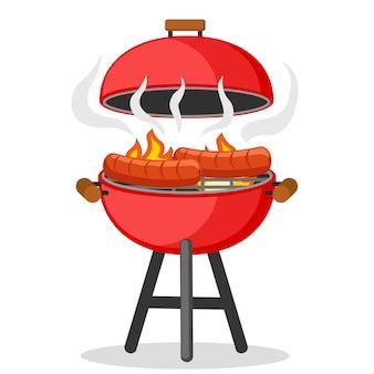 Worstjes worden gebakken op het vuur in de barbecue.