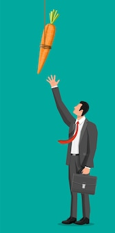Wortel op een stokje en zakenman. motivatie, stimulus, stimulans en het bereiken van de metafoor van het doelconcept. houten visstok met hangende wortel