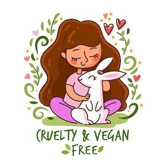 Wreedheidsvrij en veganistisch bericht met vrouw die een konijn vasthoudt
