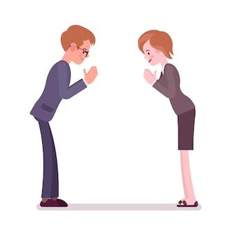 Zakelijke mannelijke en vrouwelijke partners die een boog geven