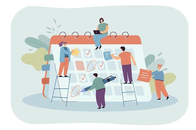 Zakelijke personen die een vergaderschema plannen met behulp van een enorme kalender