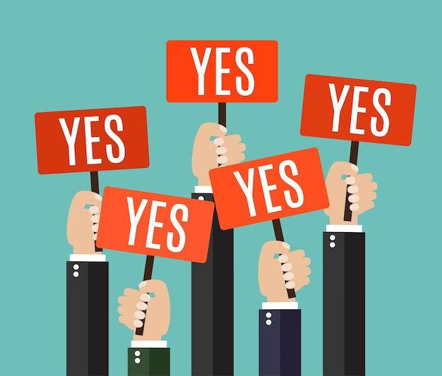 Zakenlieden die een uithangbord met het woord ja houden.