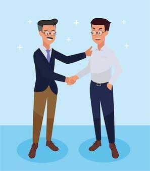 Zakenlieden schudden elkaar de hand om zakelijk succes te feliciteren