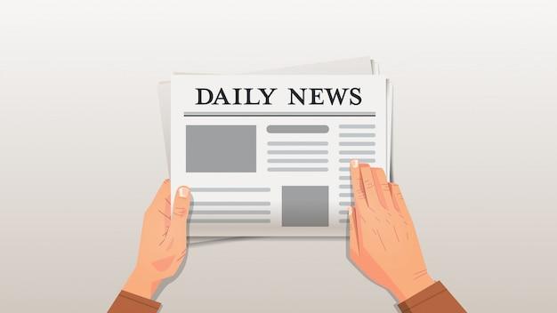 Zakenman die dagelijks nieuws menselijke handen leest die het concept van de krantenpersmassamedia houden