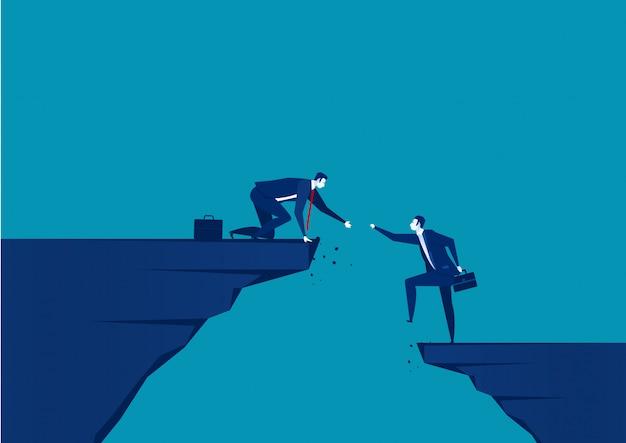 Zakenman die een andere zakenman helpt