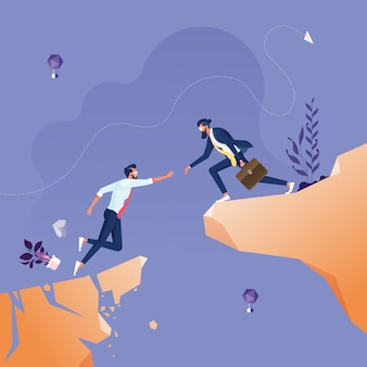 Zakenman die elkaar helpen over kloof-bedrijfsgroepswerkconcept