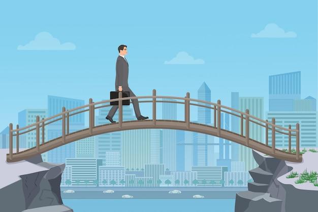Zakenman die op een brug gaat