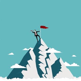 Zakenman die zich bovenop de berg bevindt