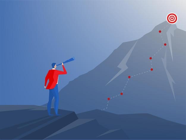 Zakenman die zich bovenop klif met telescoop bevindt