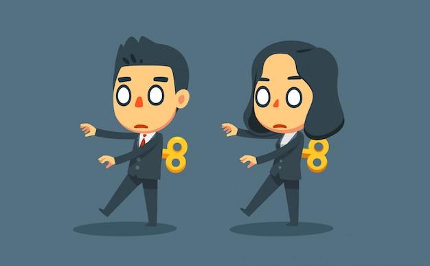 Zakenman en zakenvrouw bewegen als robot speelgoed.