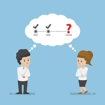 Zakenman en zakenvrouw denken over de toekomst