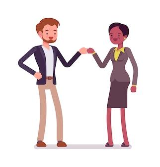 Zakenman en zakenvrouw vuist hobbel