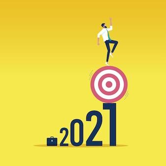 Zakenman evenwicht doel op 2021 nummer-risicobeheer uitdaging concept