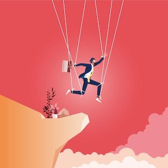 Zakenman gecontroleerd als marionet op snaren die naar de klif lopen, symbool van slechte bedrijfsethiek en moraal