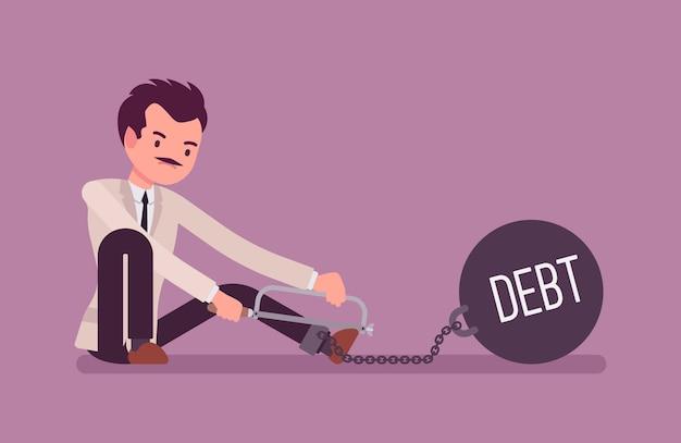 Zakenman geketend met een metaalgewicht schulden zagen