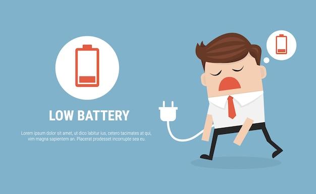 Zakenman gevoel moe en lage batterij