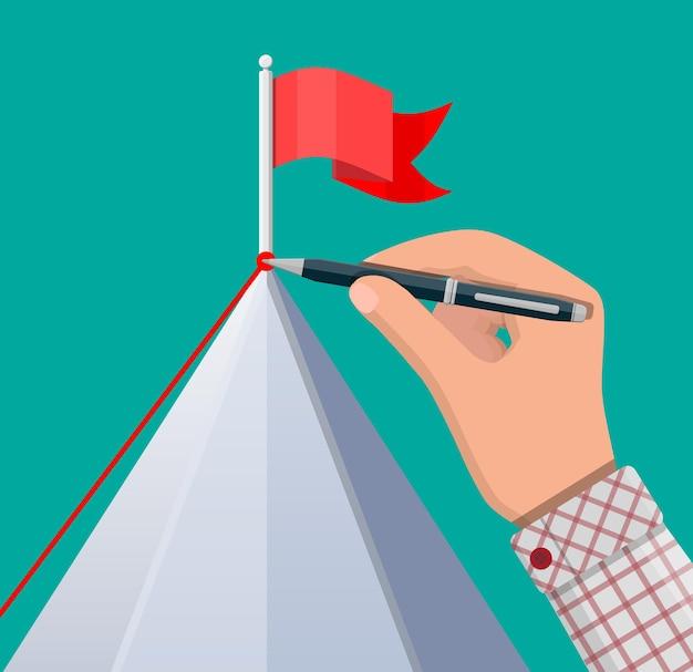 Zakenman hand met pen trekt opstelling. vlag op de top van de berg