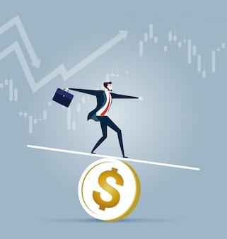 Zakenman het in evenwicht brengen op een muntstuk - bedrijfsconcept