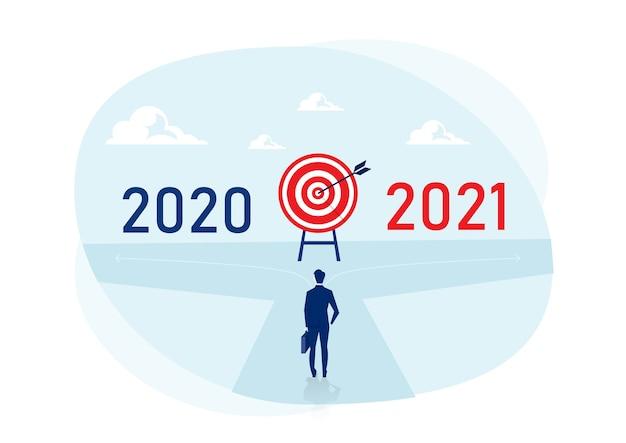 Zakenman kiest voor een nieuwe manier tussen 2020 en 2021 jaar. nieuwjaar uitdagingen concept