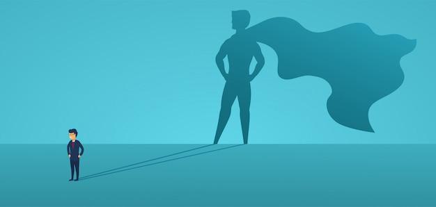 Zakenman met grote schaduw superheld. super manager leider in het bedrijfsleven. concept van succes, kwaliteit van leiderschap, vertrouwen, emancipatie.