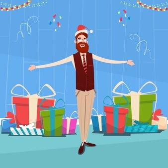 Zakenman met veel geschenkdoos