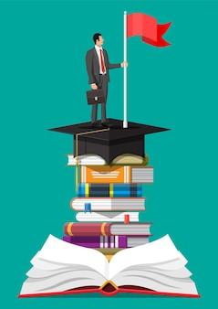 Zakenman met vlag op stapel boeken. bedrijfsmens met aktentas. onderwijs en studie. zakelijk succes, triomf, doel of prestatie. wedstrijd winnen. vector illustratie vlakke stijl