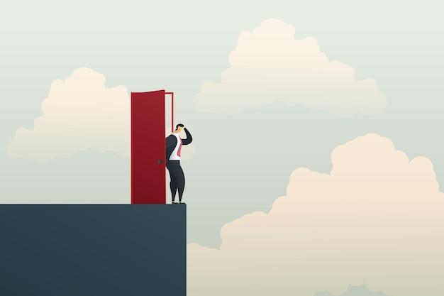 Zakenman opent de deur op de klif concept van bedrijfsfalen en carrièregroei