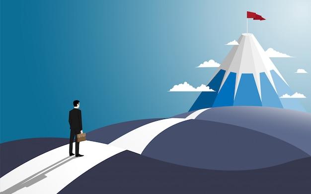 Zakenman staan op de weg kijken naar het succes gaan