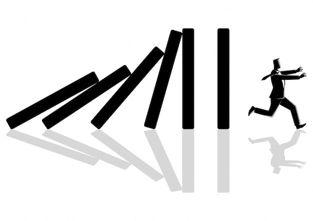 Zakenman weglopen van domino-effect