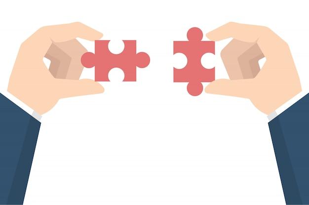 Zakenmanhanden die raadsel houden. teamwerk concept.
