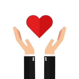Zakenmanhanden die rood hart houden