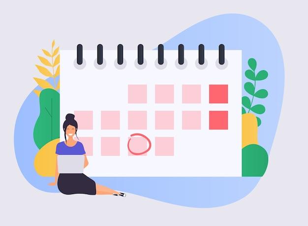 Zakenvrouw met een laptop heeft een kalenderplan