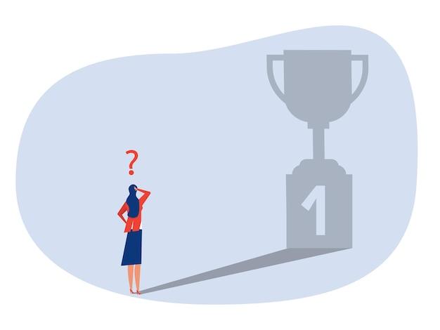 Zakenvrouwen die voor de schaduw staan en kijken, krijgen zelf een succesvolle prijs