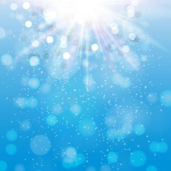 Zee blauwe achtergrond met sparkles en stralen. eps10