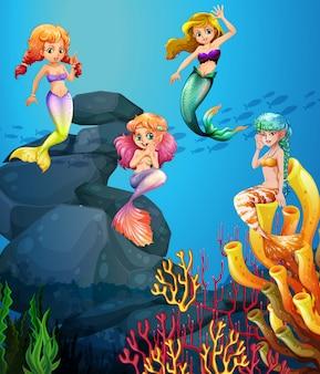 Zeemeerminnen die onder de oceaan zwemmen