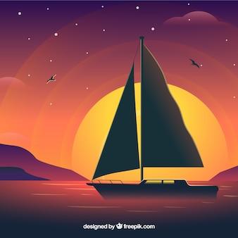 Zeilboot op de zonsondergang op de achtergrond