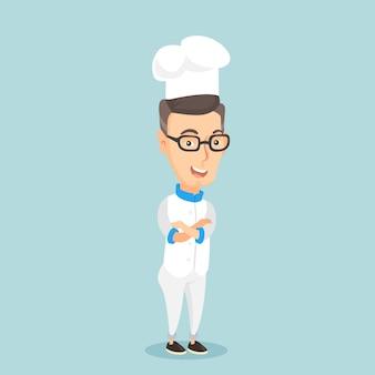 Zekere mannelijke chef-kok met gekruiste armen.