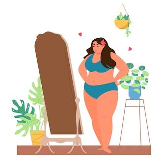 Zelfacceptatie en lichaams positief concept. grote maten vrouw in ondergoed kijkt in de spiegel en geniet van hoe ze eruitziet.