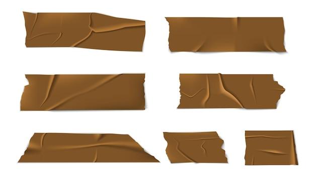 Zelfklevende plakband. strips sticker, stukjes scotch. geïsoleerde realistische gouden plakband Premium Vector