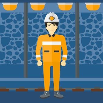 Zelfverzekerde mijnwerker in veiligheidshelm.