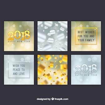 Zes vierkante nieuwe jaarkaarten in goud en zilver