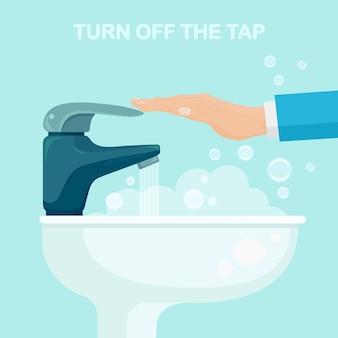 Zet de kraan aan of uit. bespaar water. gootsteen met stromend water uit de kraan