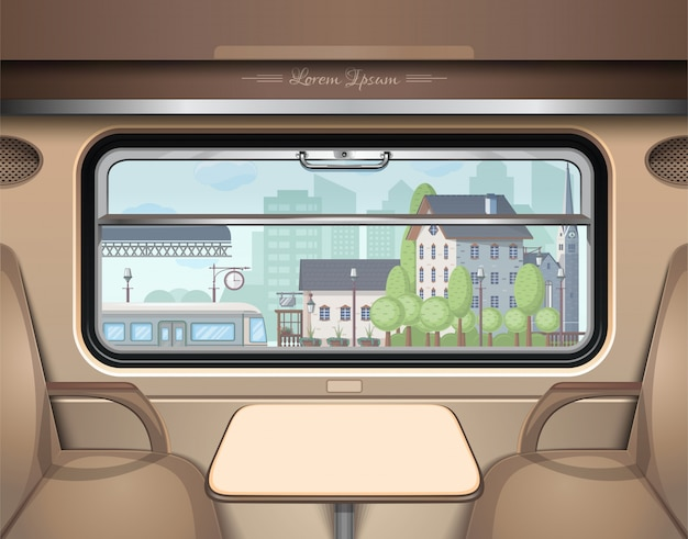 Zicht op het treinstation vanuit het treinraam.