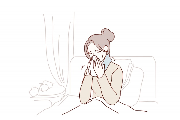 Zieke jonge vrouw gevangen koud niezen in weefsel thuis.