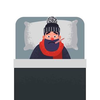 Zieke koude man in bed met een thermometer in zijn mond