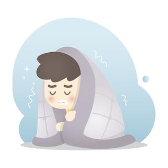Zieke man wordt koud en rilt in een warme deken