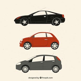 Zijaanzicht van drie platte auto's
