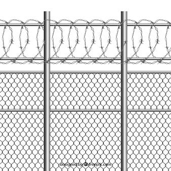 Zilveren metalen hek met prikkeldraad